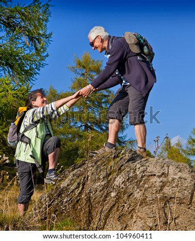 senior couple hiking in the nature - stock photo
