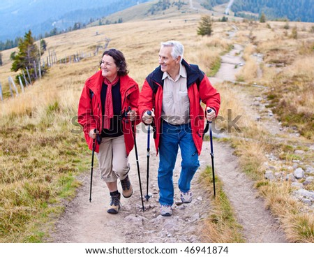 senior-couple hiking in the nature - stock photo