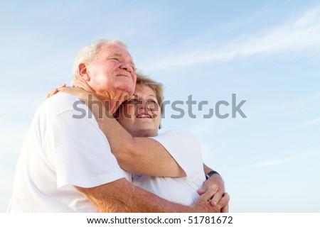 senior couple hugging - stock photo