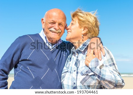 Senior couple hugging and smiling - stock photo