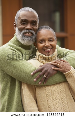 Senior couple hugging outdoors - stock photo