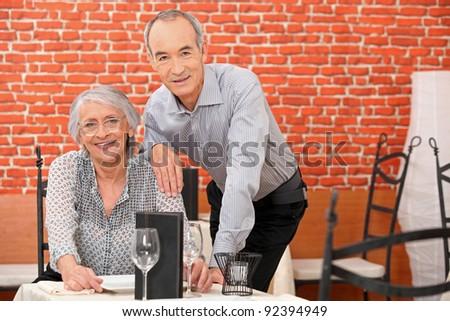 Senior couple in a restaurant - stock photo