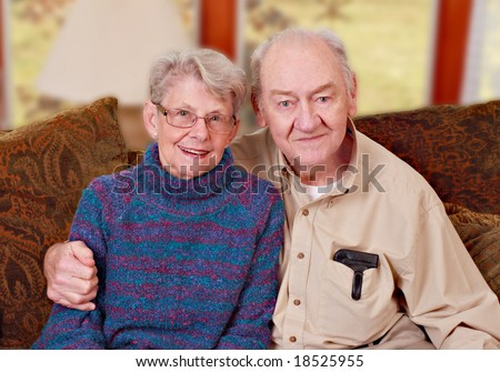 Senior couple in living room - stock photo