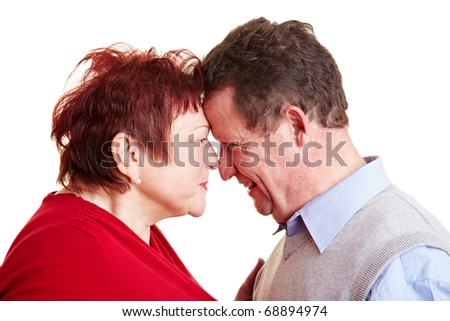 Senior couple in love looking each other into the eyes