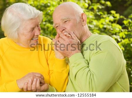 Senior couple in love outdoors - stock photo