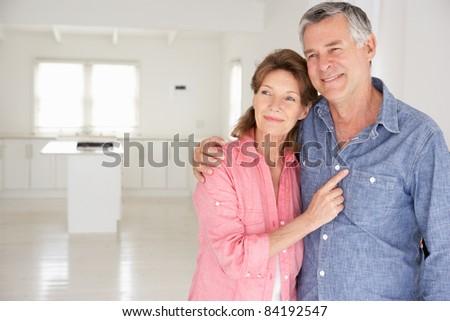 Senior couple in new home - stock photo
