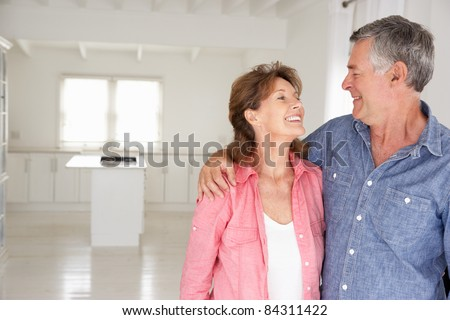 Senior couple in new home - stock photo