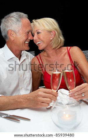 Senior couple in restaurant - stock photo