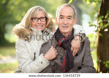 Senior couple in the woods - stock photo