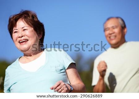 Senior couple jogging - stock photo