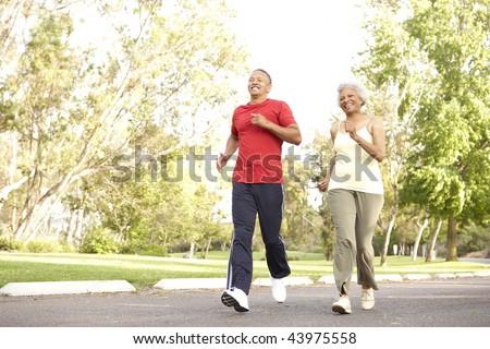 Senior Couple Jogging In Park - stock photo