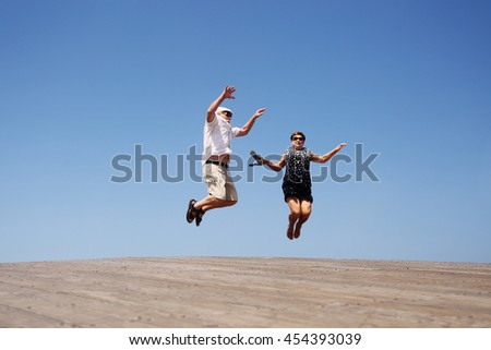 senior couple jumping - stock photo