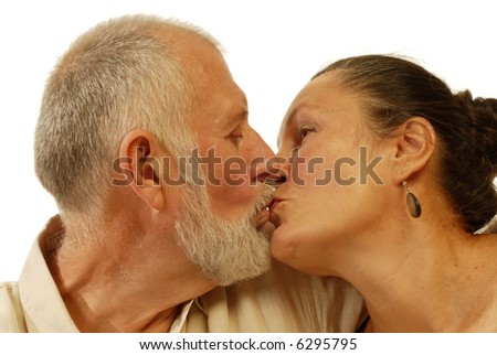 Senior couple kissing; very much in love - stock photo