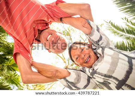 senior couple laughing and smiling - stock photo