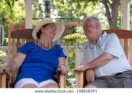 Senior couple looking at each other with trust and love - stock photo