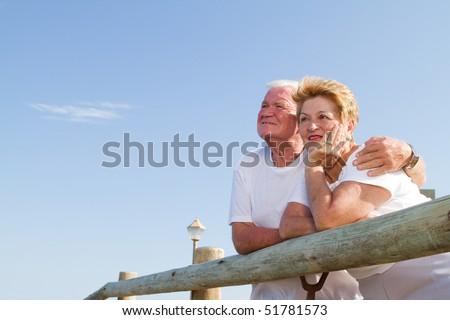 senior couple looking away - stock photo