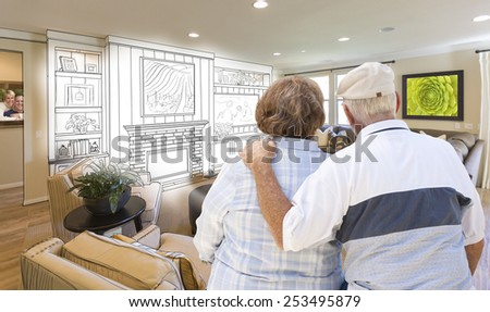 Senior Couple Looking Over Custom Living Room Design Drawing and Photo Combination. - stock photo