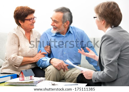 Senior couple meeting with real estate agent