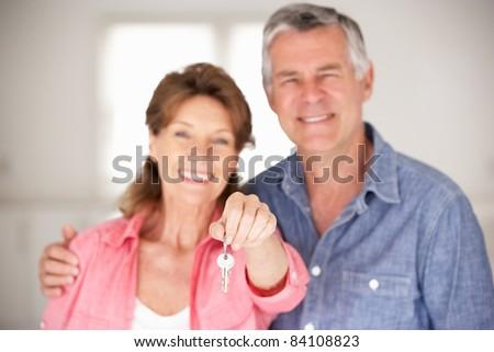 Senior couple moving into new home - stock photo