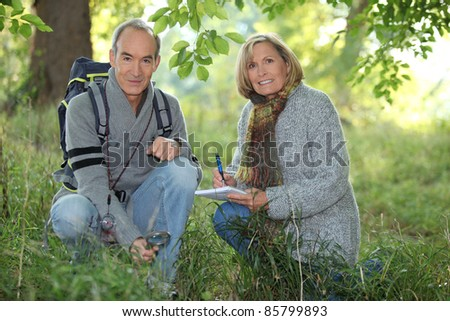 senior couple on a hike - stock photo