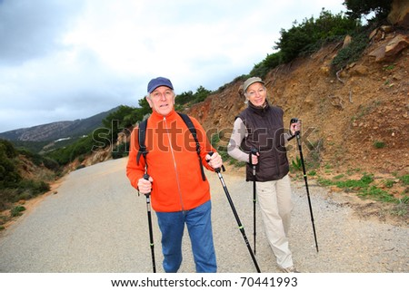 Senior couple on a walking day - stock photo