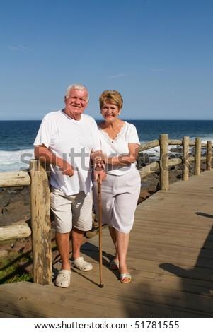 senior couple on beach - stock photo