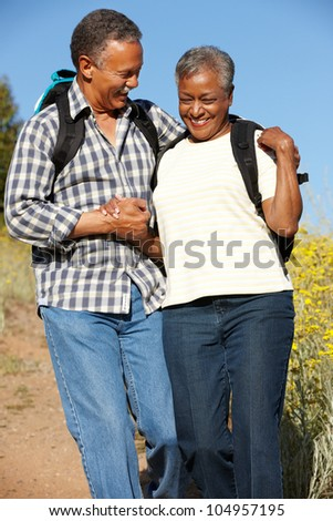 Senior   couple on country hike - stock photo