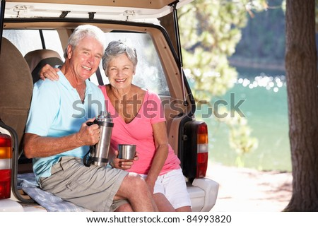 Senior couple on country picnic - stock photo