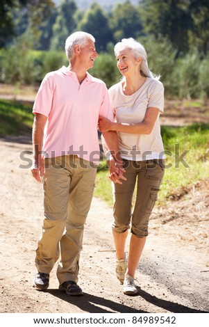 Senior couple on country walk - stock photo