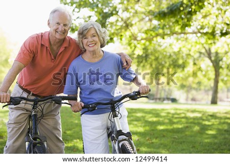 Senior couple on cycle ride in countryside