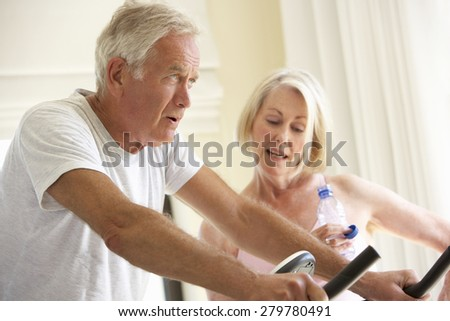 Senior Couple On Exercise Bike
