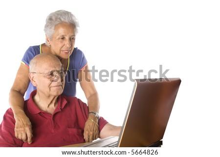 senior couple on laptop - stock photo