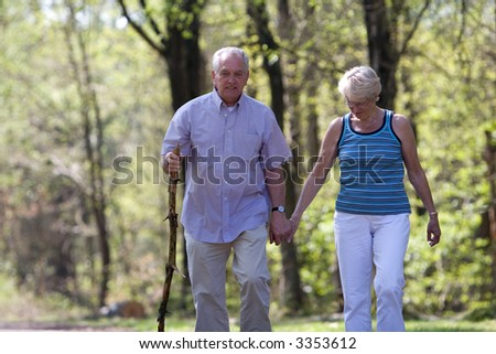 Senior couple out for a walk on a summerday - stock photo