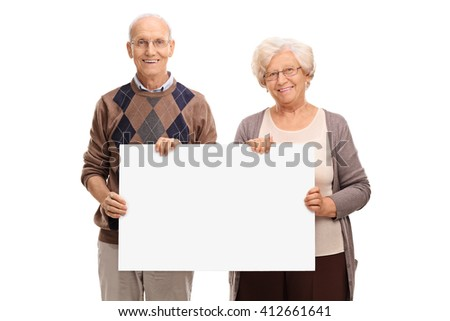 Senior couple posing together and holding a blank white signboard isolated on white background - stock photo