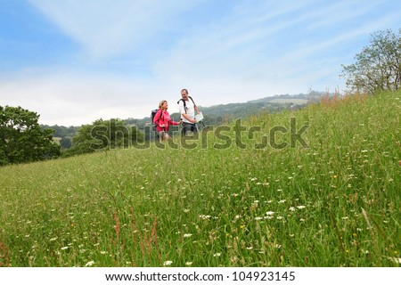 Senior couple rambling in countryside - stock photo