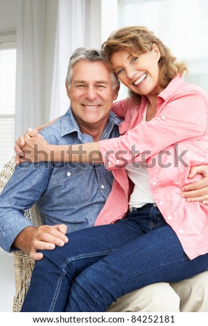 Senior couple relaxing at home - stock photo
