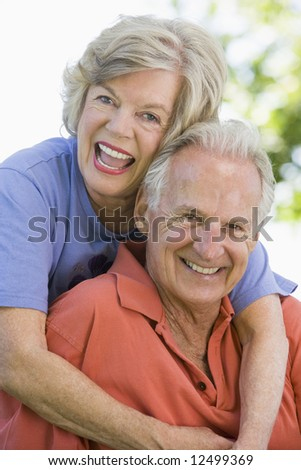 Senior couple relaxing in park together - stock photo