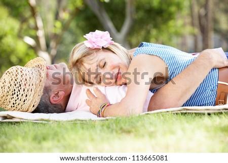 Senior Couple Relaxing In Summer Garden - stock photo