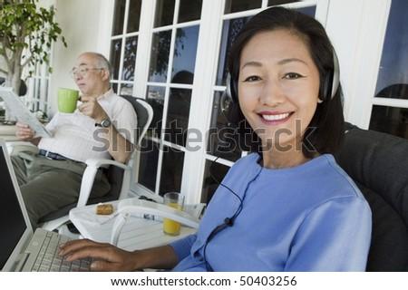 Senior couple relaxing on porch - stock photo