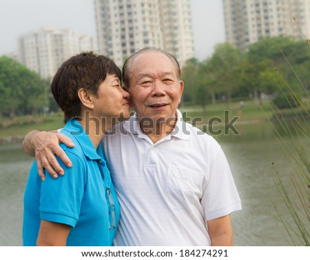 Senior couple sharing an intimate moment - stock photo