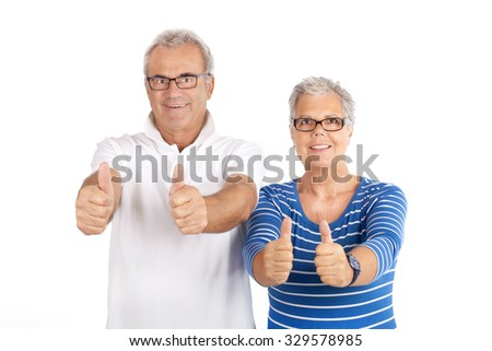 Senior couple showing ok thumbs up isolated on white background - stock photo