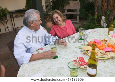 Senior couple sitting at table - stock photo