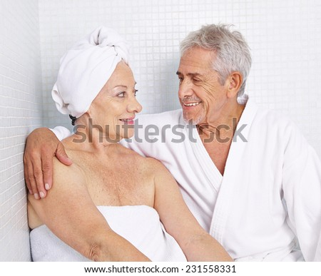 Senior couple sitting for relaxation in a spa in their holidays - stock photo
