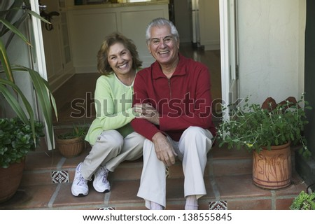 Senior couple sitting on steps