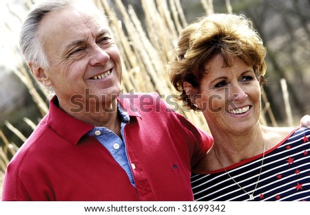Senior couple smiling - stock photo
