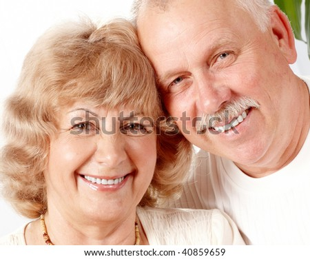 Senior couple  smiling and happy at home