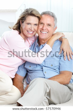 Senior couple  smiling and happy at home - stock photo