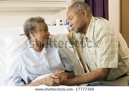 Senior Couple Standing In Hospital Together - stock photo