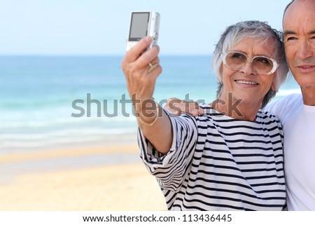 Senior couple taking  a photo - stock photo