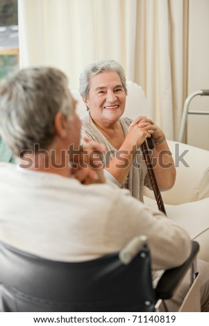 Senior couple talking in a hospital room - stock photo